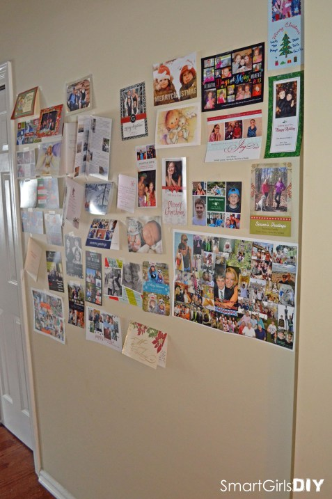 Christmas cards taped to wall
