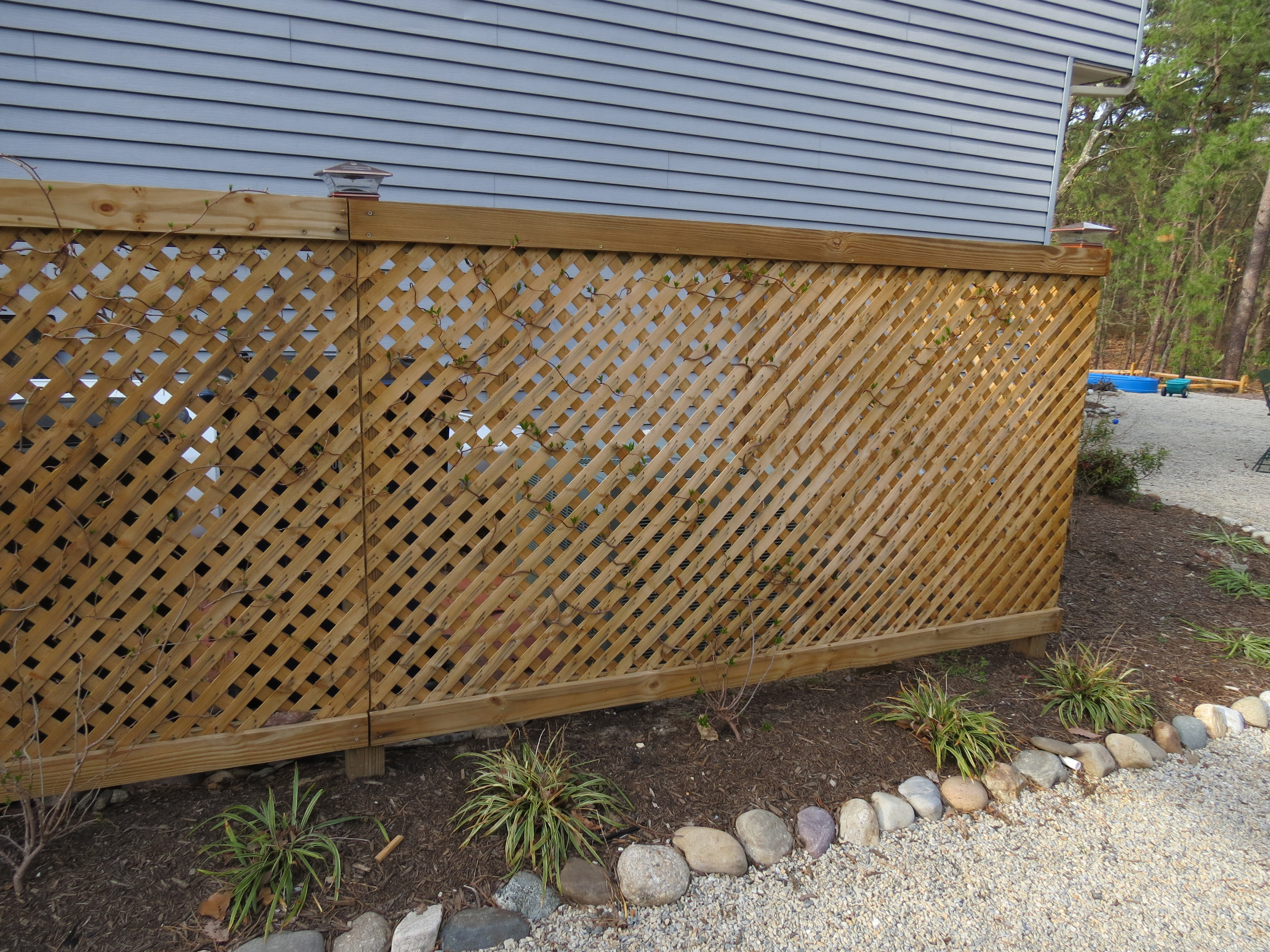 Lattice Air Conditioner Screen How To Hide Your Garbage Cans And Ac Unit With Style