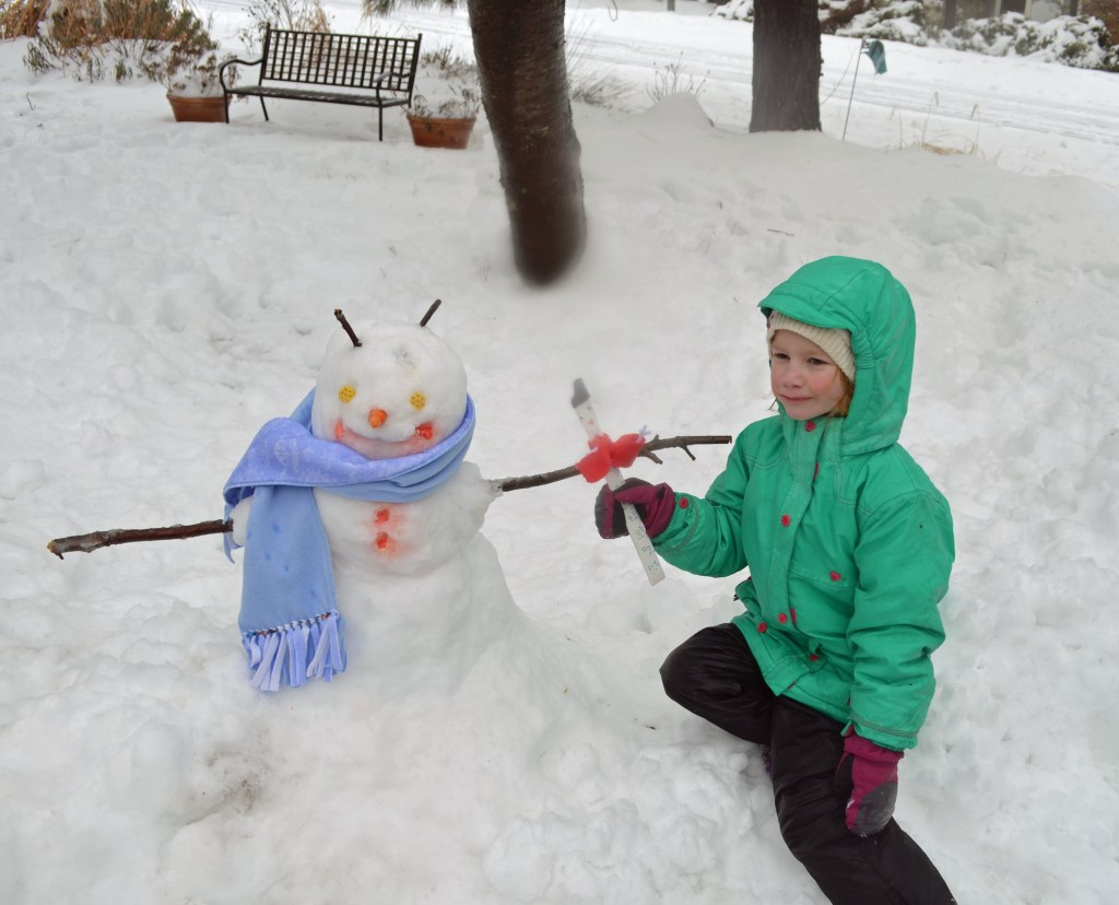 Snowman and snowman measuring stick
