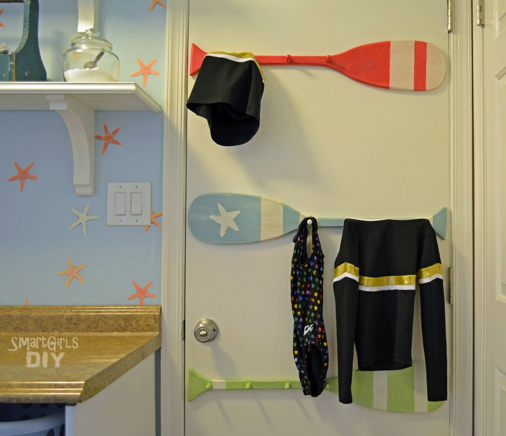 Laundry room drying racks on back of door -Smart Girls DIY