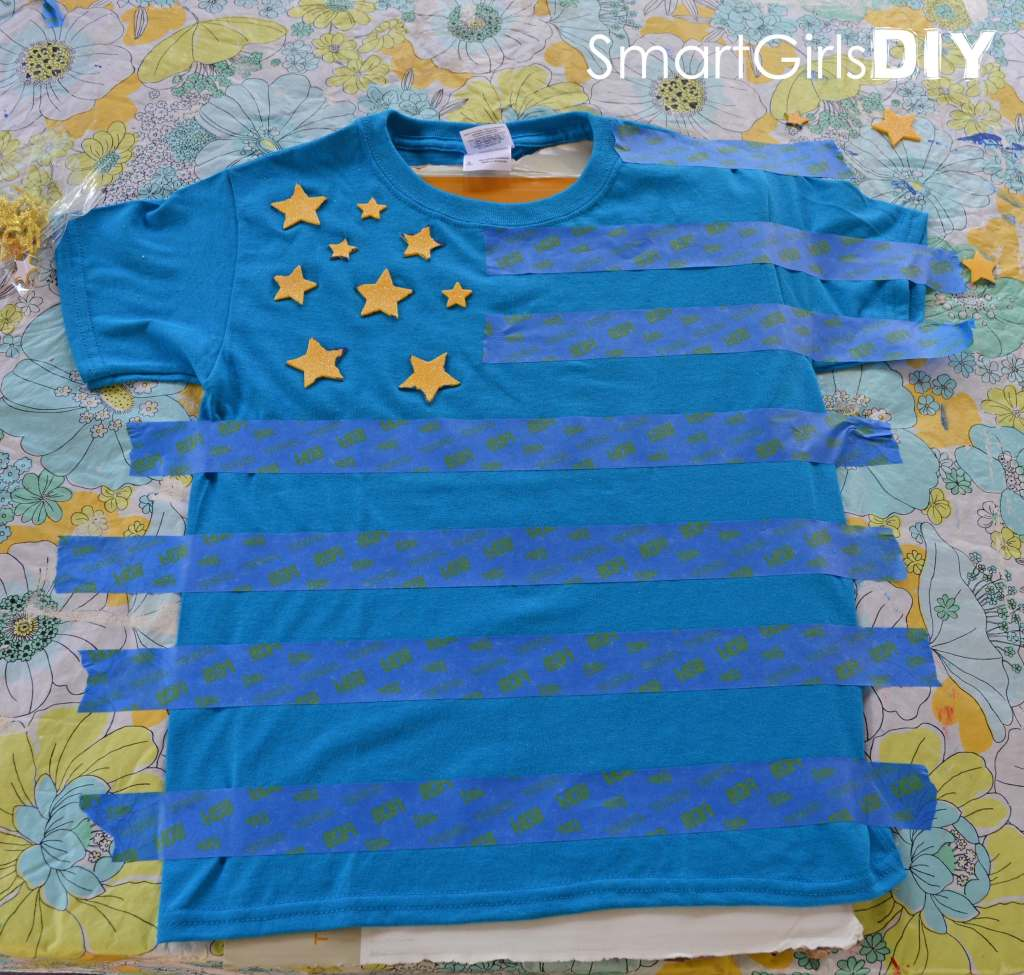 Add tape and stickers to shirt
