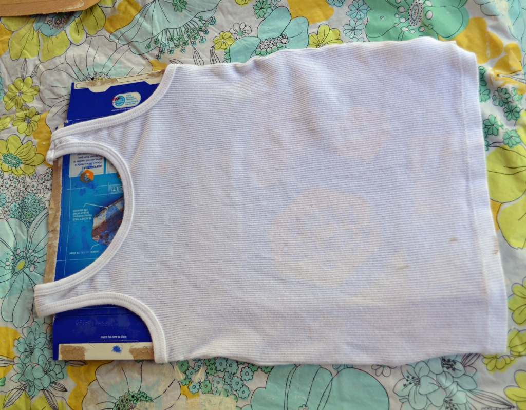 Put cardboard inside shirt