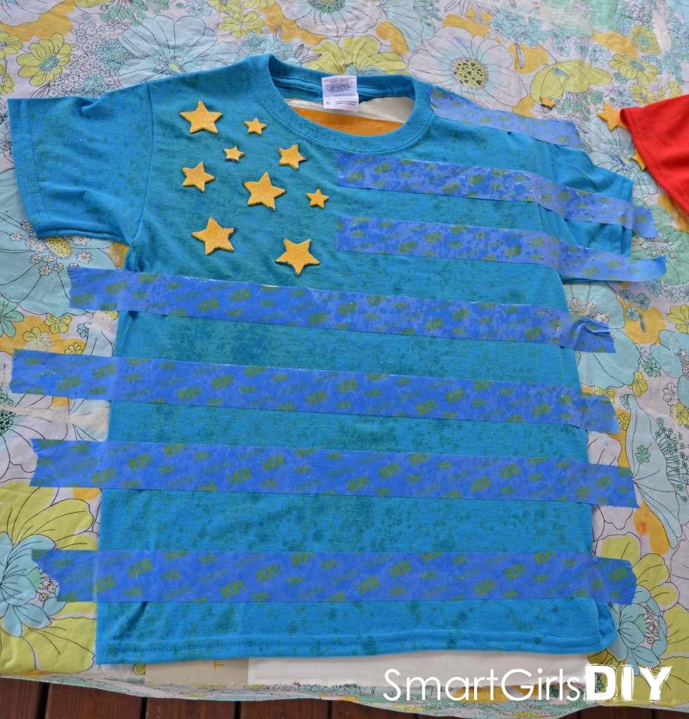 Spritz bleach on blue shirt