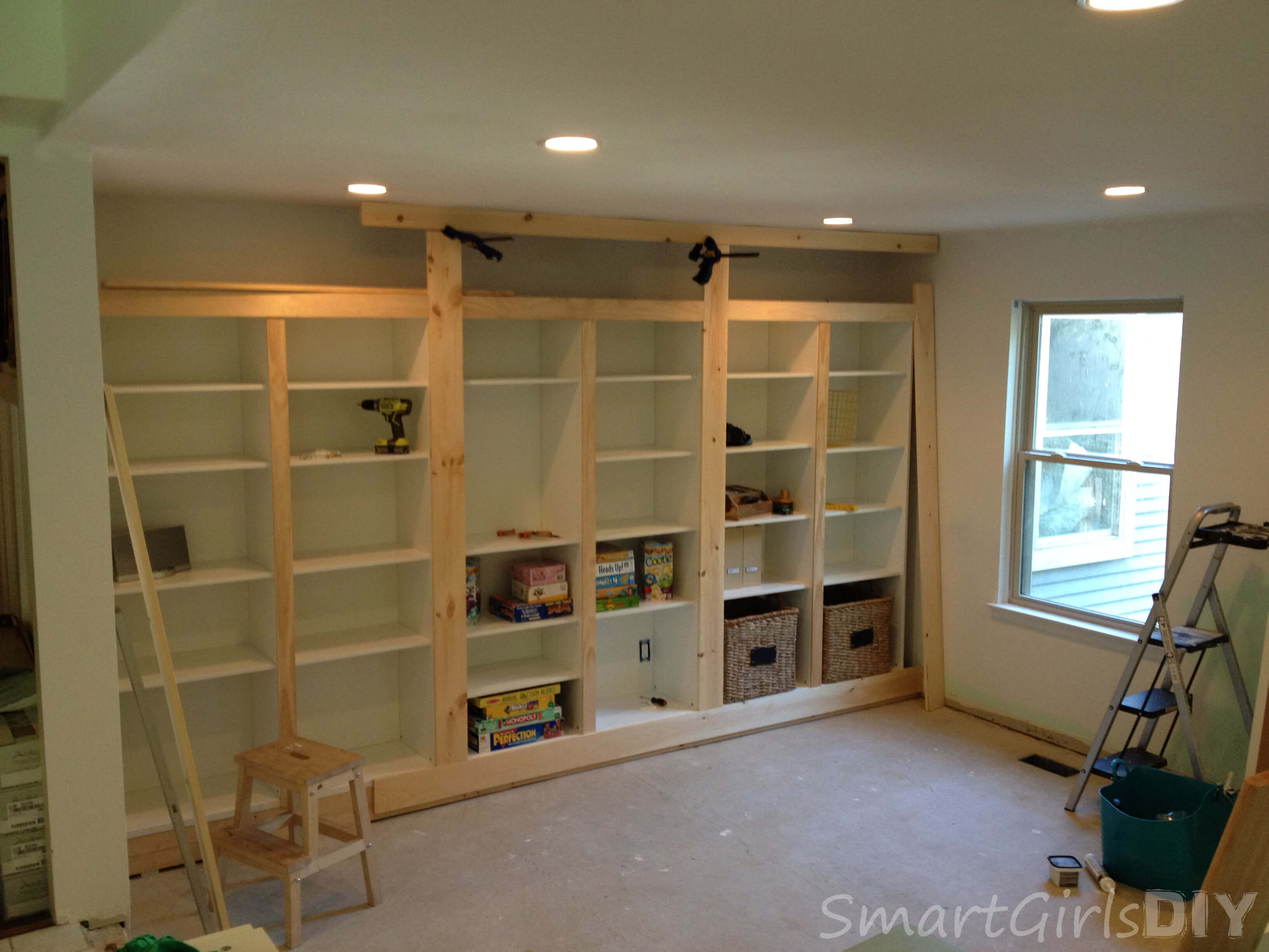 DIY Builtin Bookshelves Using Ikea BESTA Family Room - Diy built in shelves