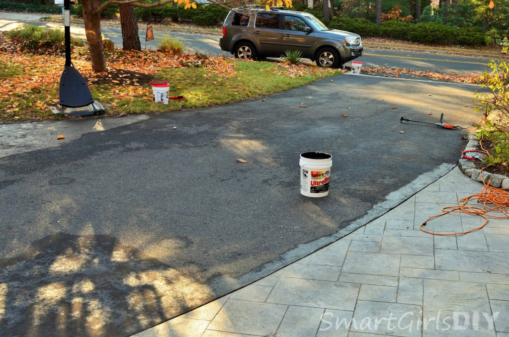 Painting the asphalt around the edge of stamped concrete