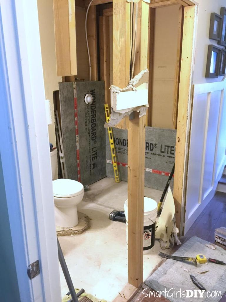 How to install a pocket door -- step 1 remove existing door frame and and adjacent wall