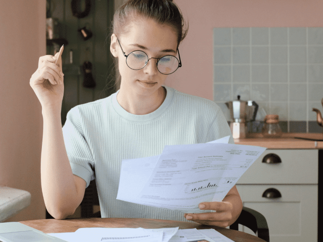 Tax tips - woman doing business taxes