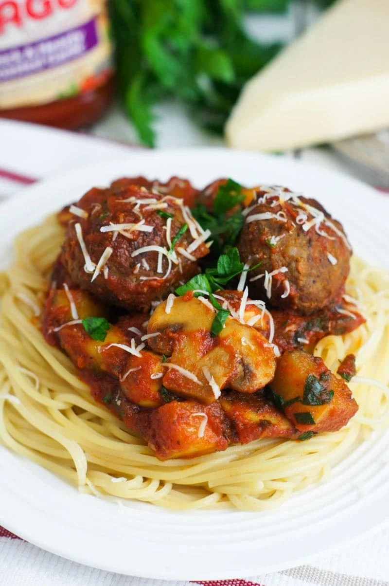 Mushrooms and Zucchini Bolognese with Italian Style Meatballs ~ A hearty sauce filled vegetables and made easy with the NEW Ragu Homestyle pasta sauces. Add meatballs and pour over a bed of spaghetti for a delicious pasta dinner.