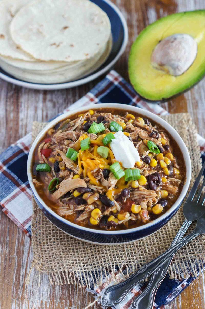 Filled with chicken, beans, veggies and great spices, this Slow Cooker Taco Chicken Chili is hearty, spicy and full of flavor. #slowcooker #chili