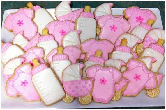 Bottle and pram baby shower sugar cookies
