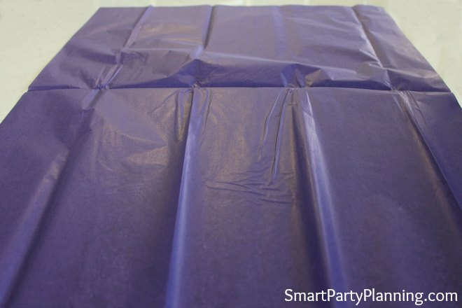 Spread out the tissue paper flat.
