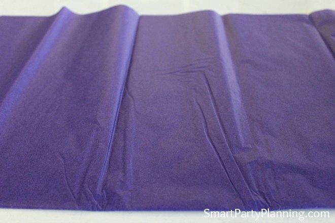 Fold tissue paper in half
