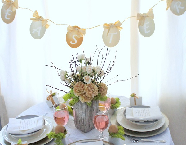 Easter table with an Easter banner above it