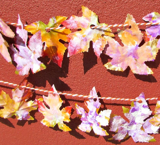 Colorful fall leaves strung on twine to make a garland