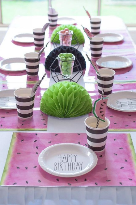 Kids table setting with watermelon napkins, plates and cups