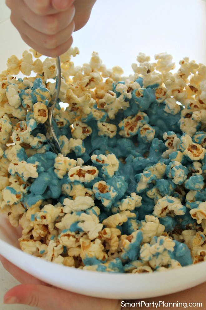 mix in the chocolate into the popcorn