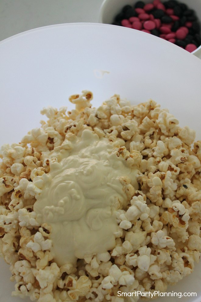 Pour chocolate over popcorn