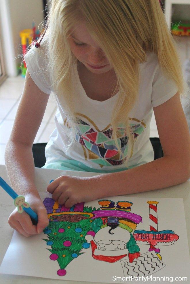 Child coloring in santa coloring sheets