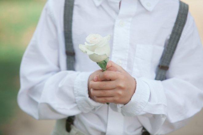 Boy holding a rose