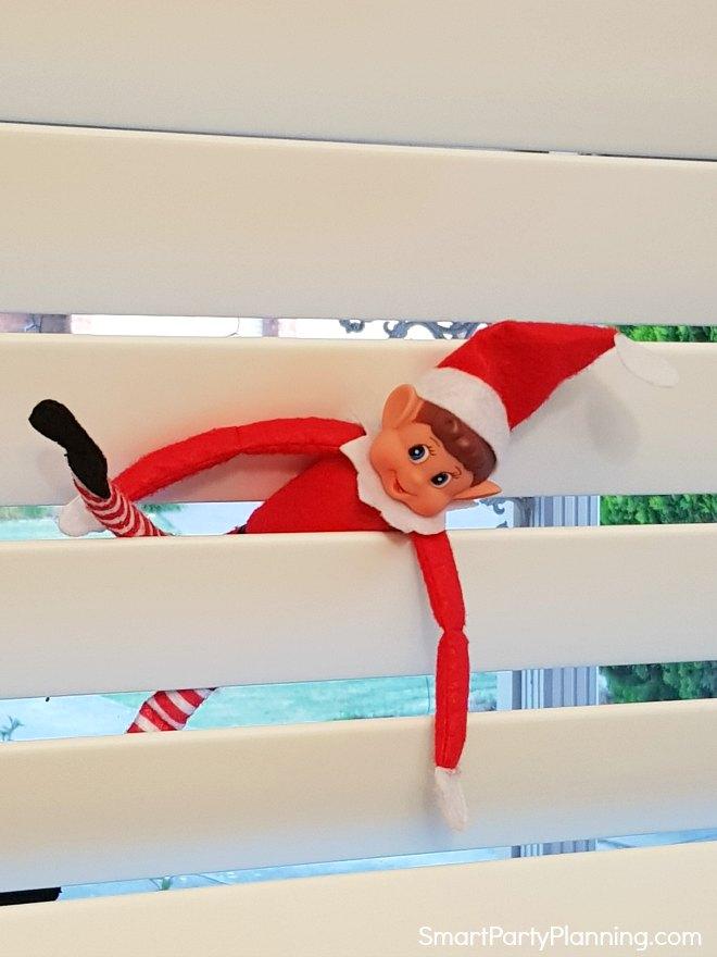 Elf on the Shelf climbing through the window