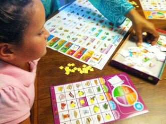 Children playing MyPlate Food Bingo - a healthy food choice game for kids