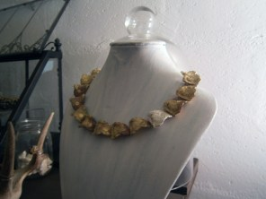 One of Emilie's jewelry designs. Handmade out of metal and painted in gold.