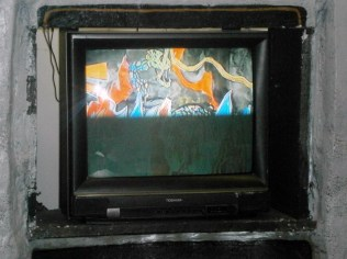 Maia built a fake vintage TV to house this actual TV monitor and DVD player to show her stop-motion animations