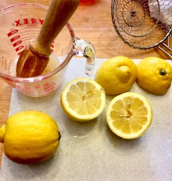 Some halved, squeezed, and whole lemons.