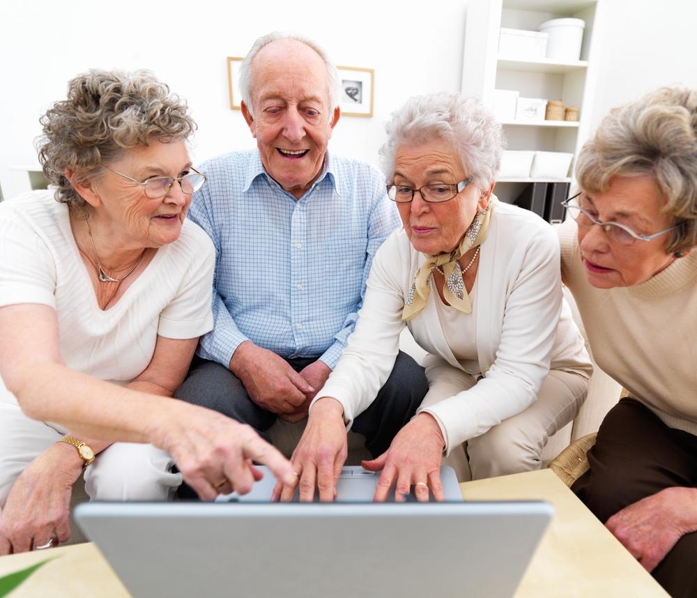 elderly people on computer