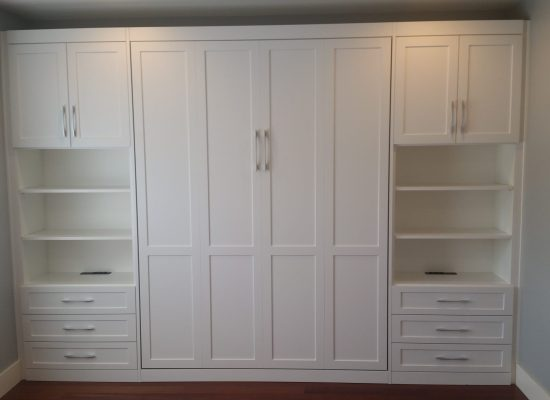 Guest bedroom makeover, custom Murphy bed installed, vertical, wall to wall, small spaces, custom cabinetry. SmartSpaces.com