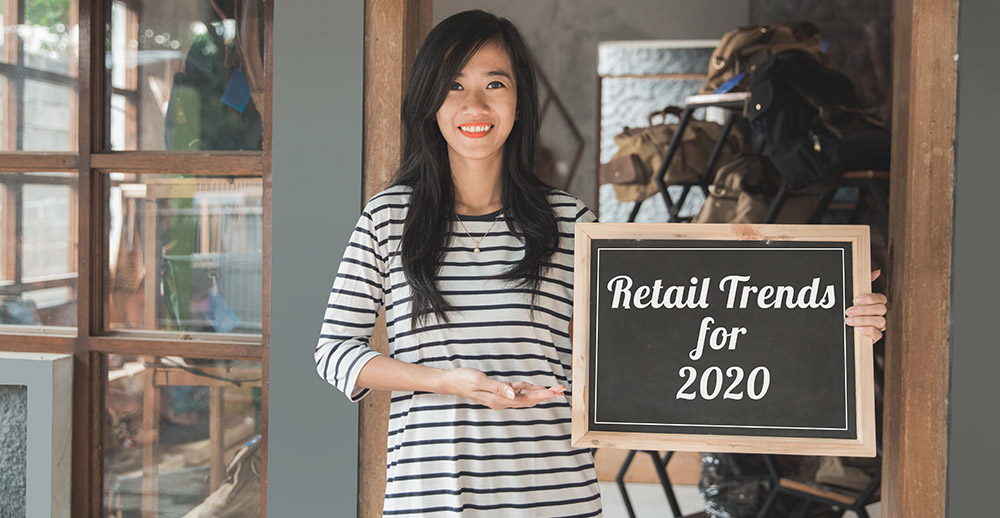 business owner holding a blackboard what will retail look like in 2020