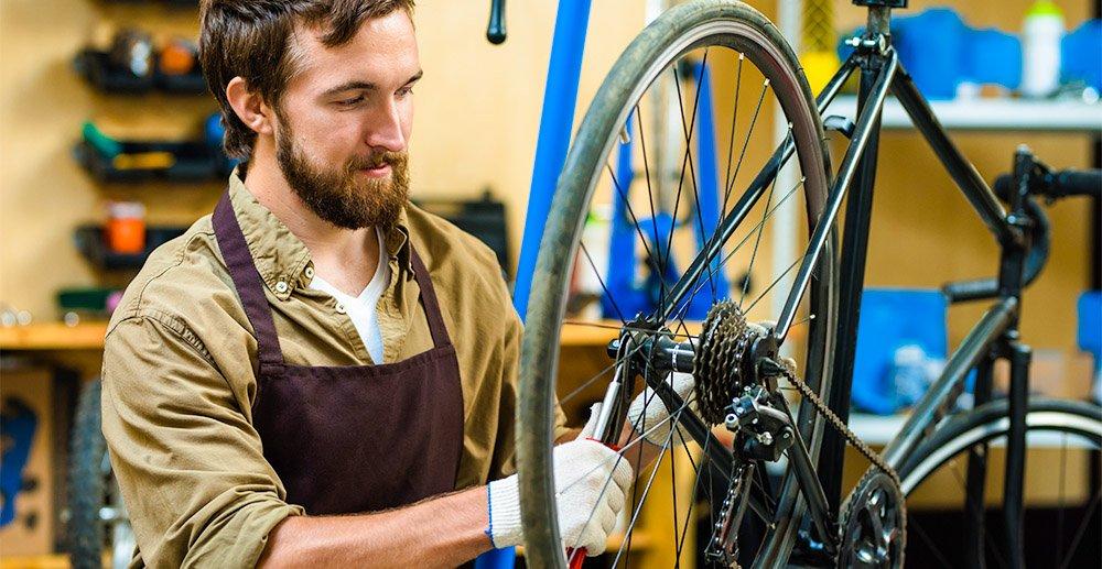 man repairing bike how to improve product repair services