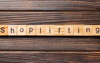 """tiles on desk spelling """"shoplifting"""""""