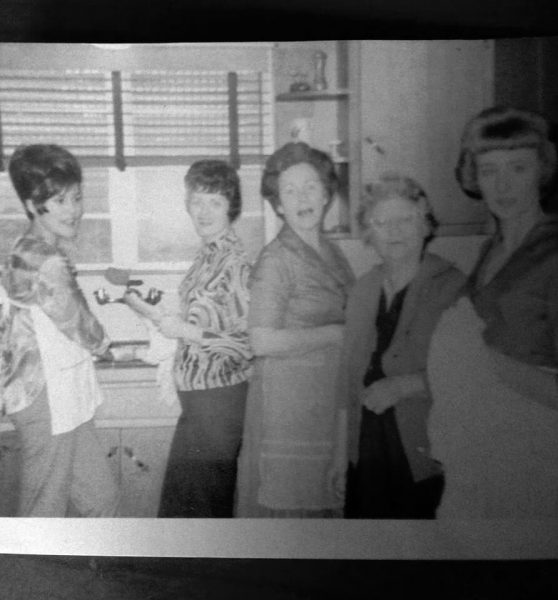Black and white picture of her aunts, grandmother's and great grandmother in the kitchen
