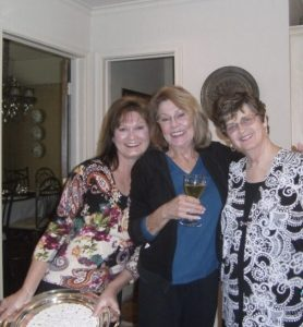 Anecia her mother and aunt in kitchen smiling