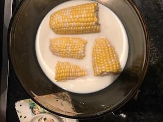 Corn cobs soaking in milk make the corn sweeter