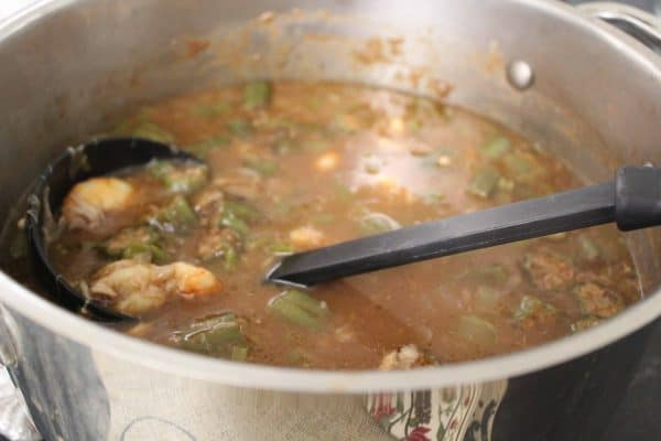 Seafood gumbo in large stockpot on stove