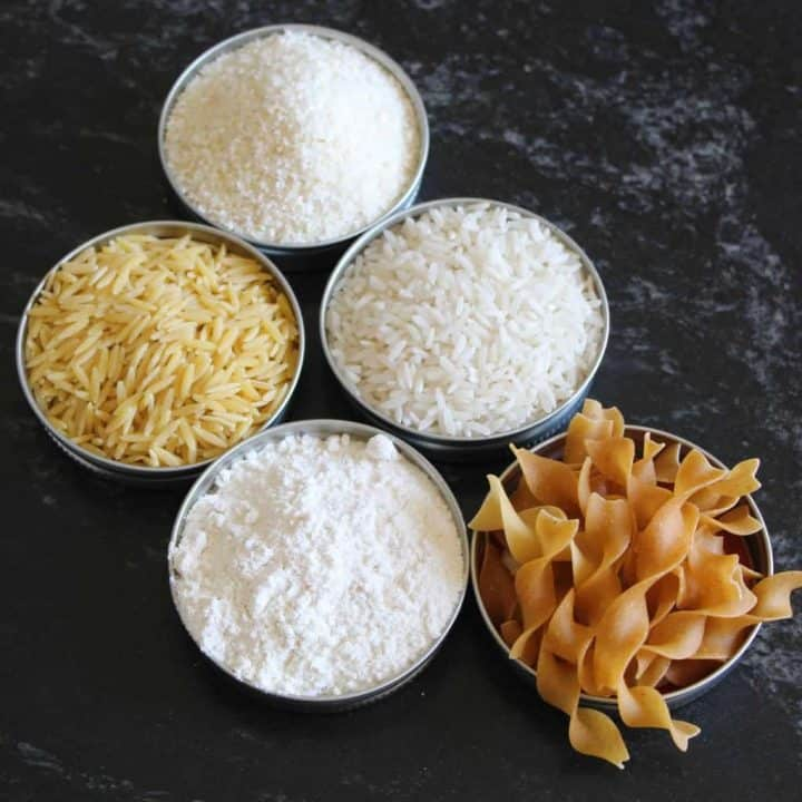 5 ramekins with grains on countertop rice, pasta, noodles, flour, cornstarch