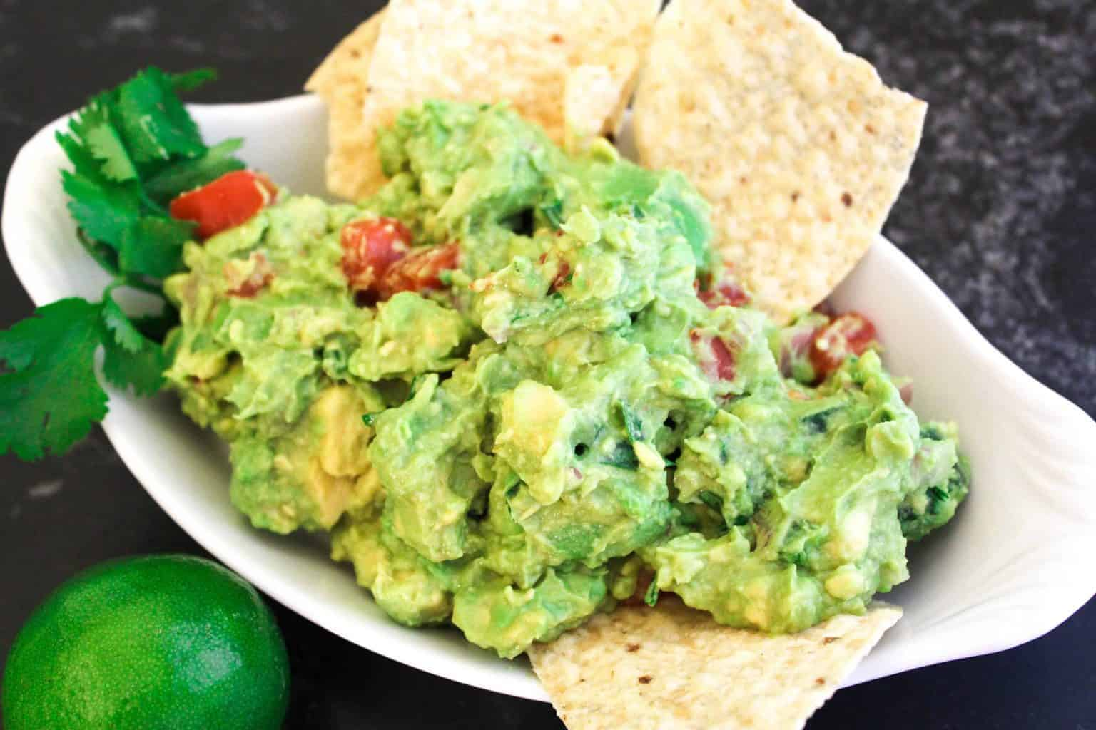 Close up image of guacamole with tortilla chips