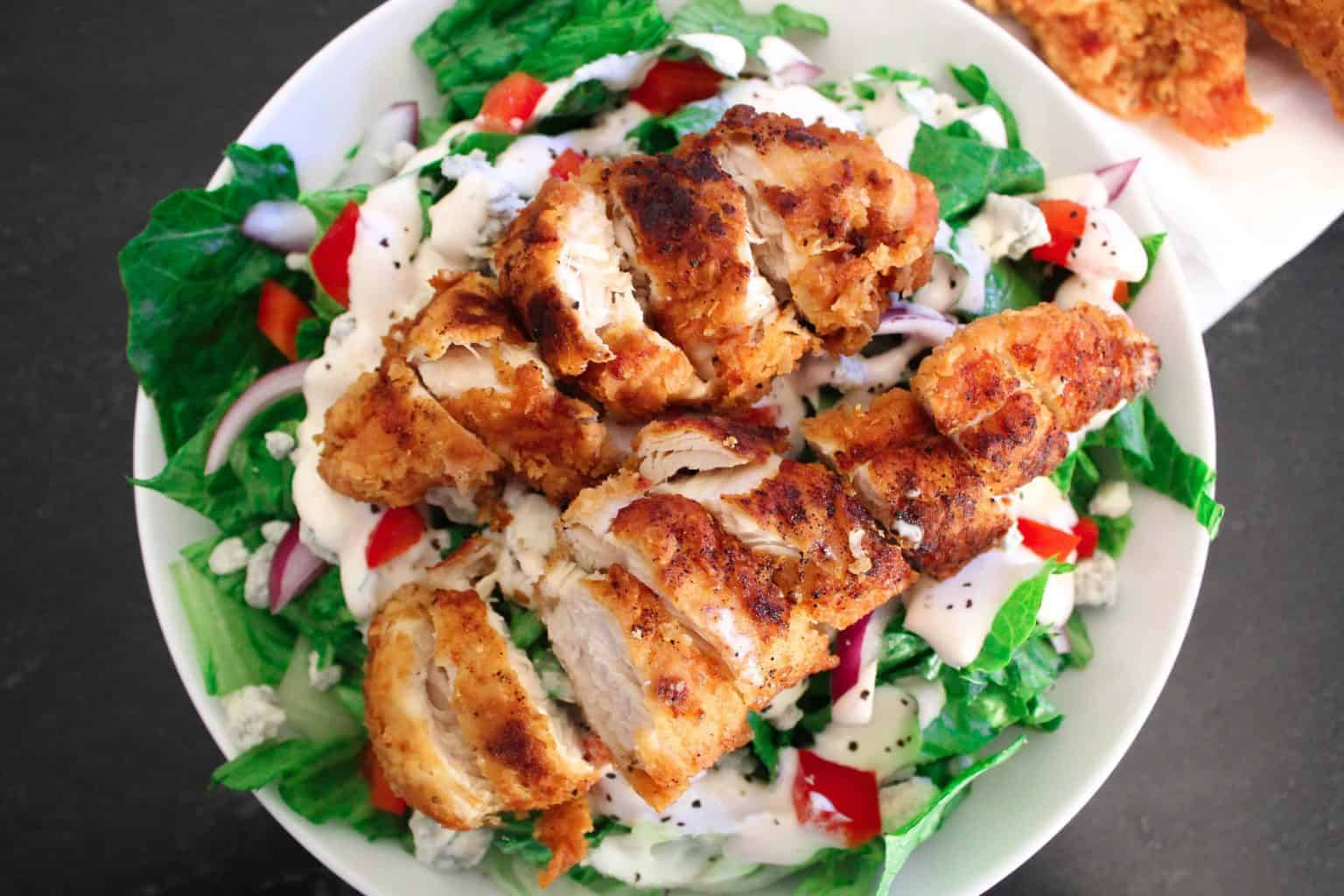 Fried Chicken Tenders Salad in a white bowl