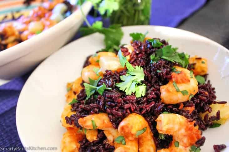 Spicy Harissa Shrimp with Black Rice garnished with cilantro