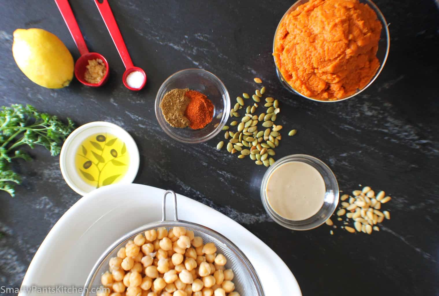 Ingredients for hummus on black marble counter