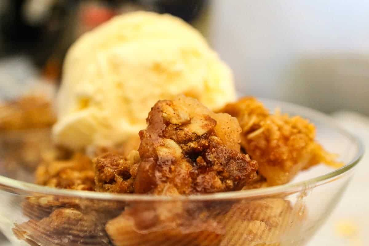 Easy Apple Crisp or Apple Crumb in a bowl with ice cream