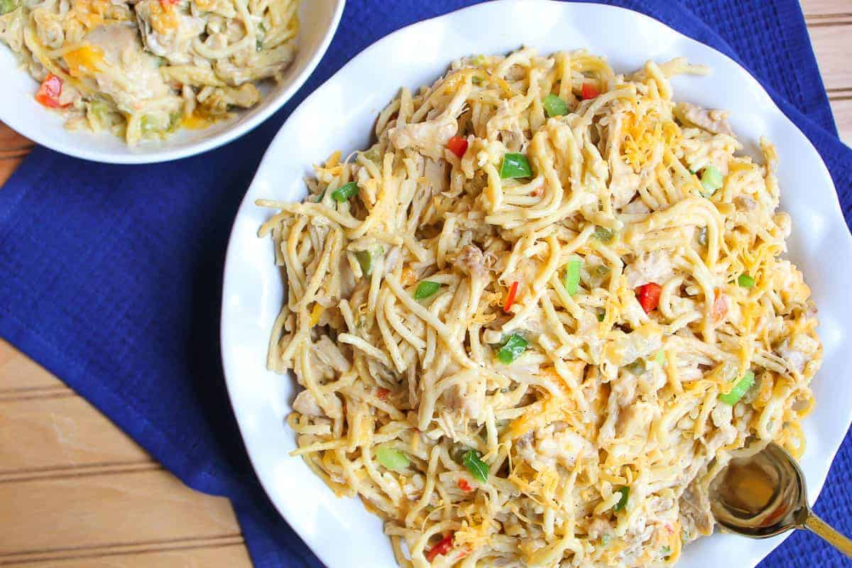 Chicken spaghetti in white bowl.
