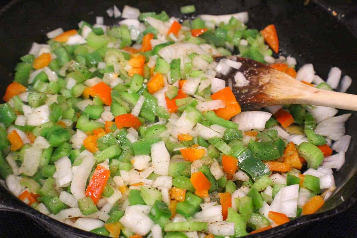 Saute peppers and onions as a base for chicken spaghetti