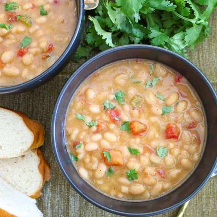 Black bowl full of navy bean soup