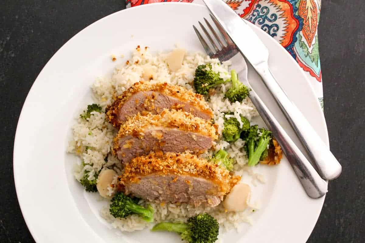 Sliced Panko Crusted Pork Tenderloin with white rice and broccoli
