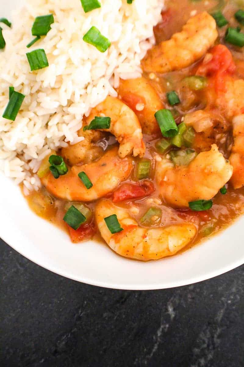 Louisiana Shrimp Etoufee in white bowl with side of rice