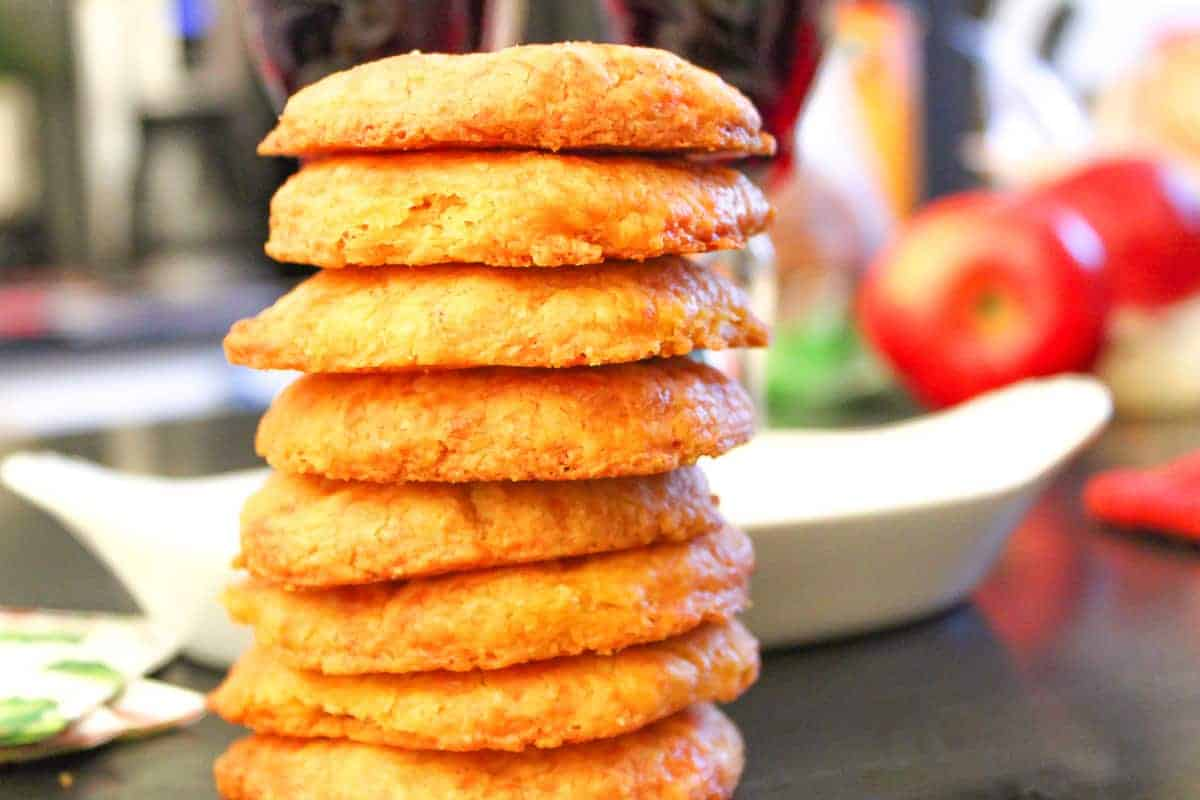 Cheddar cheese wafers stacked on counter top