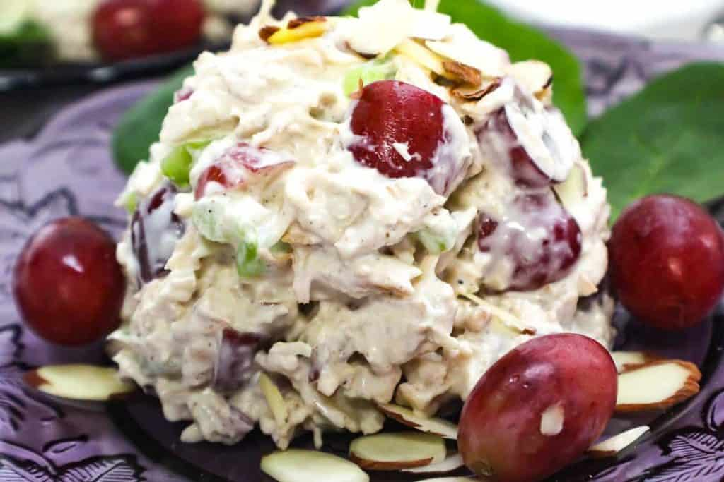 A big scoop of leftover smoked turkey salad with red grapes and celery